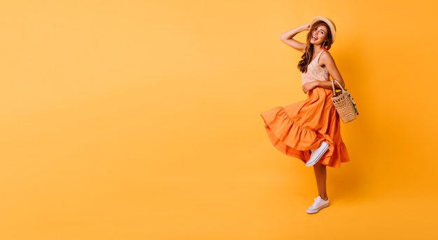 magnificent-woman-long-bright-skirt-dancing-studio-carefree-inspired-female-model-posing-with-pleasure-yellow_197531-11084